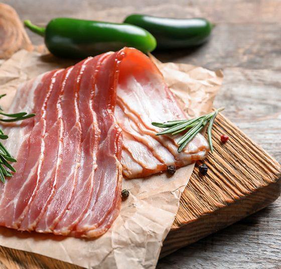 Bacon on wooden board
